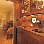 The galley tucked between living and dining rooms is a combination pantry and bar with custom-built mahogany cabinets and backsplash.