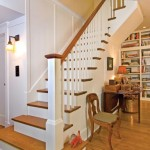 A graceful staircase with quarter-sawn oak treads and white trim replaced a 1960s-era open staircase.
