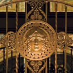 Tiffany touches throughout the hotel include an ethereal medallion on the lobby rail and artful, angelic hardware in the Empire Room that serves as a tieback for securing the latches of open casement windows.