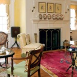 In the living room, an eclectic collection of antique furniture reflects the house's age.