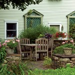 Irena, an avid gardener, designed the home's landscape, incorporating a shady terrace for al fresco meals.