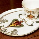 An Austrian breakfast cup-and-saucer set displays a stylized, two-dimensional pattern.