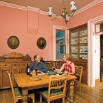 The dining room features original wainscoting and moldings; Dylan and Kate refinished the room's original wood floors.