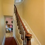 The narrow, curving staircase is a fine example of the quality craftsmanship Arnett insisted on for his home.