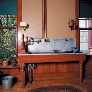 Along with the hand force pump for running water, the task-specific placement of the gaslight bracket indicates that this sink, at Billings Farm in Vermont, is in a state-of-the-art kitchen for the 1890s. (Photo: Carolyn Bates)