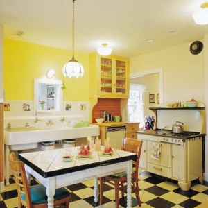 Why flood a kitchen that's clearly from the 1930s with Disco-era down-lights? Instead, use the originial milk-glass ceiling and sink fixtures to provide authentic ambient light, while almost invisible can lights stand ready to shine on the stove. (Courtesy: Carolyn L. Bates)