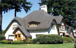This 1925 Dolph Park Storybook home features a jaw-dropping rolled-edge roof that imitates the look of English thatch.