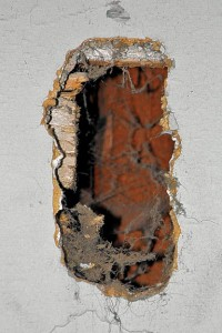 Creating a clean cut via a hole saw or careful work will make it easier to make walls or ceilings whole again. Uneven access holes, like this one punched in the author's house, prove difficult to patch.