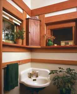 Wall-hung, corner lavatories are a common sight in old buildings, and easy to obtain for a half-bath. Most antiques have double faucets, though three-hole basins made for mixing faucets do pop up. (Photo: Linda Svendsen)