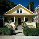 Homeowner Sandy Miller works in the dooryard garden in front of her cherished front porch.