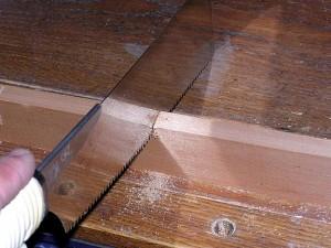 Japanese handsaw cutting wood