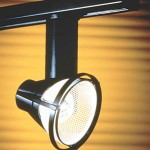 Track lights, while always surface mounted, can be more adaptable to period architecture in miniature sizes and low-voltage systems.