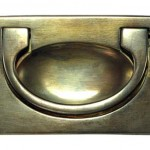 Flush cabinet handle in antiqued brass by Whitechapel Ltd.