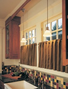 Feeling handy and have access to a sewing machine? Café curtains are among the easiest items to sew, requiring only side seams, a bottom hem, and a slot for a casement rod. This fancier grommet design hung on casement hardware from Rejuvenation requires a bit more skill to complete.