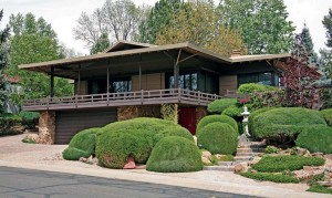 Developer Edward Hawkins designed many Arapahoe houses, including this one built for his own family. Inspired by a trip to Japan, the home recalls traditional Japanese house construction and landscaping. The two-car garage, however, is strictly mid-century American.