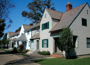A group of row houses sports varied roof-lines, façades, and porch treatments.
