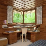 Cypress ceiling panels, corner windows, and a built-in desk with shelves draw the eye into the master bedroom.