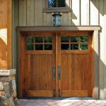 With their rail-and-stile construction, divided top lights, and convincing hardware, these swing-out garage doors give the impression of a second entryway.