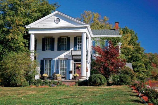 The two-columned pedimented portico on this house is unusual, and possibly an alteration to the core Greek Revival design.