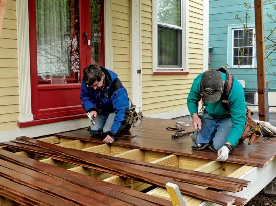After gluing the first three boards together, Ted and Mike blind-nail the rest of the decking boards into place.
