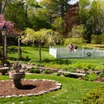 Over the years, the couple has added stone walls and planted flower beds. The vegetable garden is enclosed by a deer-proof picket fence.
