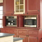 Design of the hutch accommodates the microwave oven and coffee maker, visible only when in use.