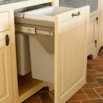 The custom cabinets disguise modern conveniences, including a large refrigerator/freezer and recycling bins.