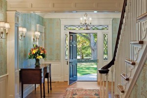 The front door's sidelights are made of antique glass. The door hardware is reproduction unlacquered brass.