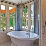 A soaking tub takes in views of the landscape.