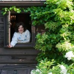 Lynne looks out from the kitchen window, past climbing hydrangea.