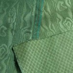 "Three green embossed-design fabrics by Thistle Hill Weavers: at left, a repp weave with a ribbed texture; at right and below, plain-woven fabrics; all three embossed—two with the ""bark"" moiré and one with a simple diamond pattern. Photo: Richard Walker"