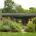 Mature gardens and a canopy of trees enhance the house today.