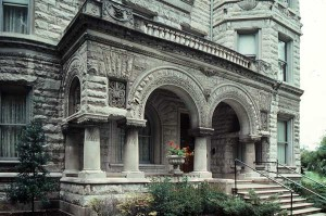 Louisville's Conrad House illustrates the decorated massiveness of the Romanesque Revival, especially its porch with squat columns and round arches. (Photo: James C. Massey)