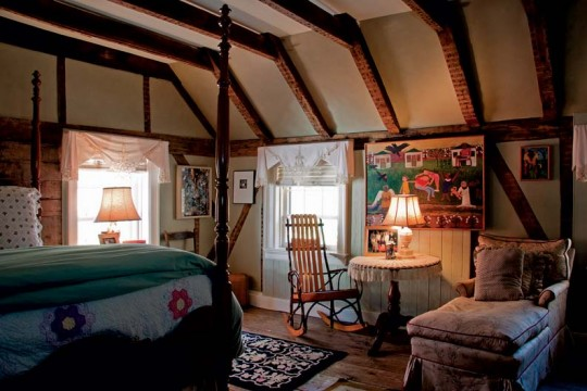 In the upstairs bedrooms, the team highlighted original construction with exposed framing.