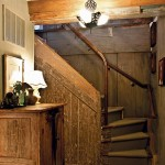 The staircase that winds up to the log cabin's second floor highlights the mixture of old and new in the house: Rough-finished walls mingle with a polished wood banister crafted by Charles.
