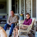 Builder Charles Snead and homeowner Neil Keller visit on the house's spacious back porch.