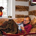 The cozy living room is one of Neil's favorite reading spots.