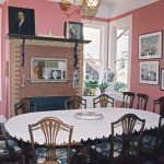 Adding to the house's eclectic style, the dining room's rose-colored brick fireplace sports an oak mantel and stone quoin detailing at the corners.