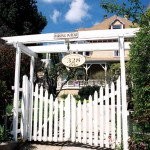 Many hands came together to restore this residence; Margaret's brother built the pergola gate—a great fit with the Queen Anne Style.