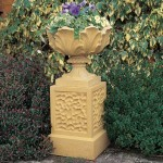Flanking the door with a pair of urn-style planters is an easy way to increase your floral bounty; this one from Haddonstone draws on a period motif of stylized acanthus leaves.