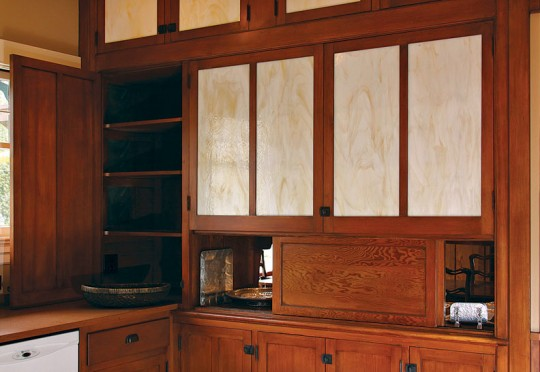 The existing built-in pantry was fitted with new cabinet doors; only the sliding doors on the pass-through (which were stripped of white paint) are original.