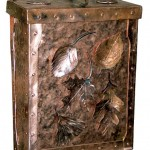 Blacksmith Matthew Harris's nature-themed mailbox features hand-riveted joinery and hand-hammered surfaces. The leaves (including oak and ginko, shown) are customizable.