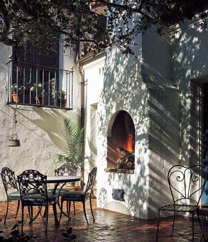 An authentic new spanish colonial old house online old for Spanish outdoor fireplace