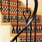 The staircase is finished in decorative Spanish tiles.