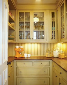 Plain and Fancy Cabinetry, located in Pennsylvania, designed this traditionally styled dish pantry. Note the use of beadboard and wood countertops.