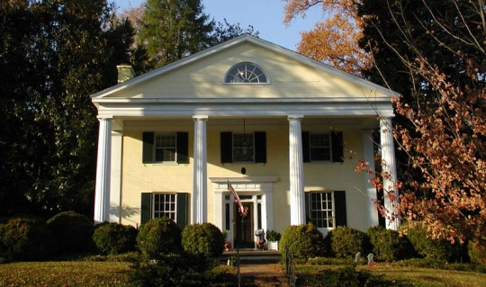 The classical porches of Greek Revival helped enhance the homes' stately entrances.