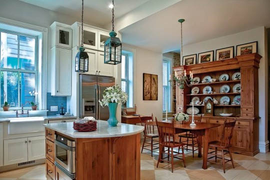 An antique hutch creates warmth in the dining area. The antique table was one of the couple's first purchases together.