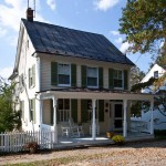 The simple 1906 Merchant House is dressed up with a Folk Victorian-style front porch.