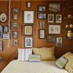 The west side bedroom has a gallery of family photos. Jan's grandmother wove the striped pillows.