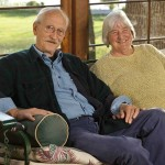 Jan Marshall Fox and her partner, Don Bednarek, on the porch with the lake behind them.